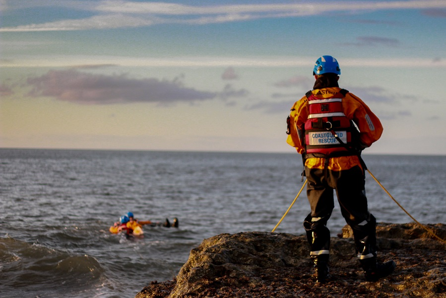 Coastguards in the sea