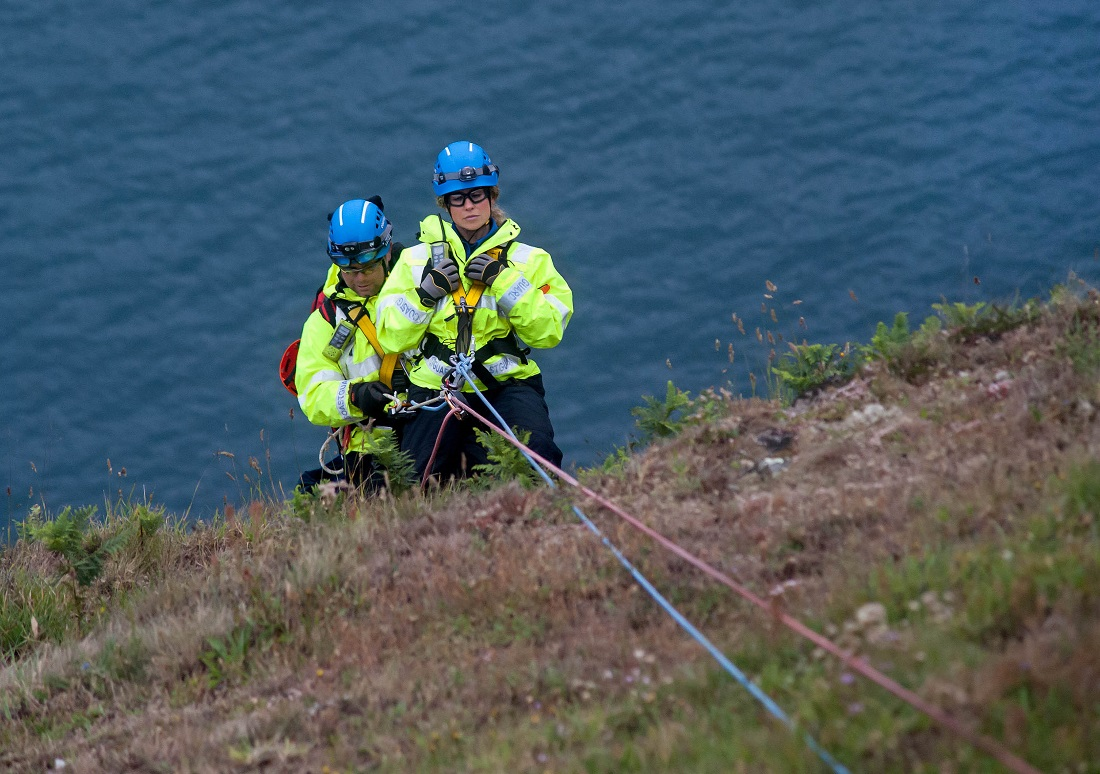 Coastguards on a cliff